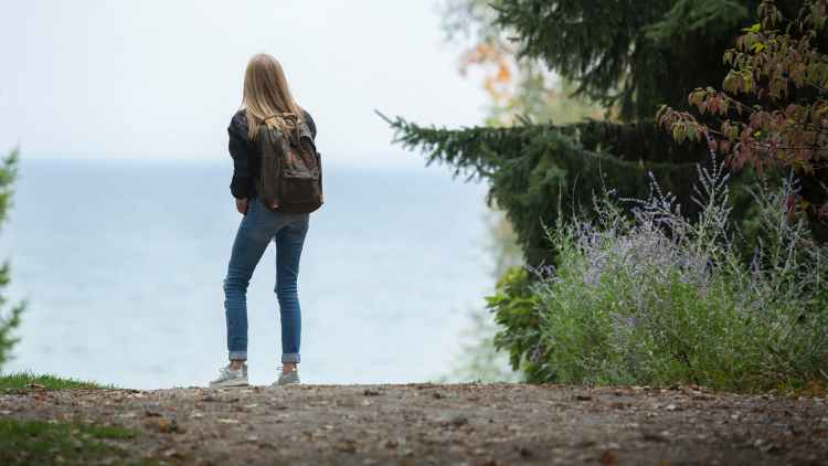 adventure backpack beach blonde